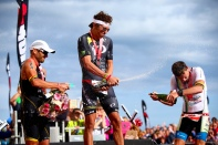 PEMBROKE, WALES - SEPTEMBER 13: Gold medalist Jesse Thomas of the USA (C), Silver medalist Andrej Vistica of Croatia (L) and Bronze medalist Markus Thomschke of Germany (R) celebrate after winning Ironman Wales on September 13, 2015 in Pembroke, Wales. (Photo by Jordan Mansfield/Getty Images for Ironman) *** Local Caption *** Jesse Thomas; Andrej Vistica; Markus Thomschke